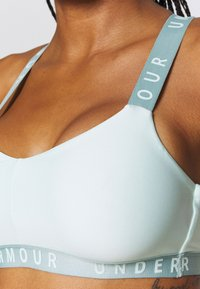 Under Armour - WORDMARK STRAPPY SPORTLETTE - Sports bra - seaglass blue - 4