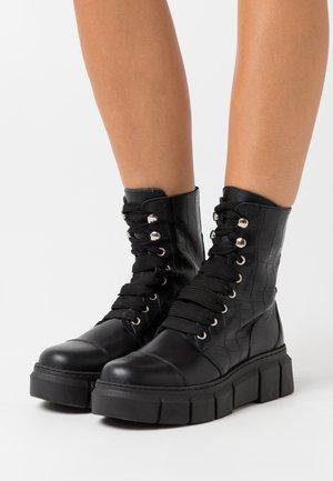 CAN  - Platform ankle boots - black