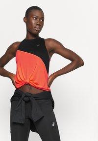 ASICS - TOKYO TANK - Sports shirt - performance black/flash coral - 4