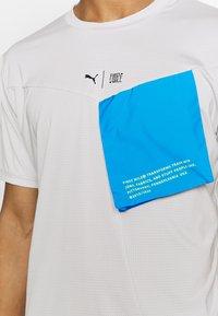 Puma - TRAIN FIRST MILE XTREME TEE - Sports shirt - gray violet - 3