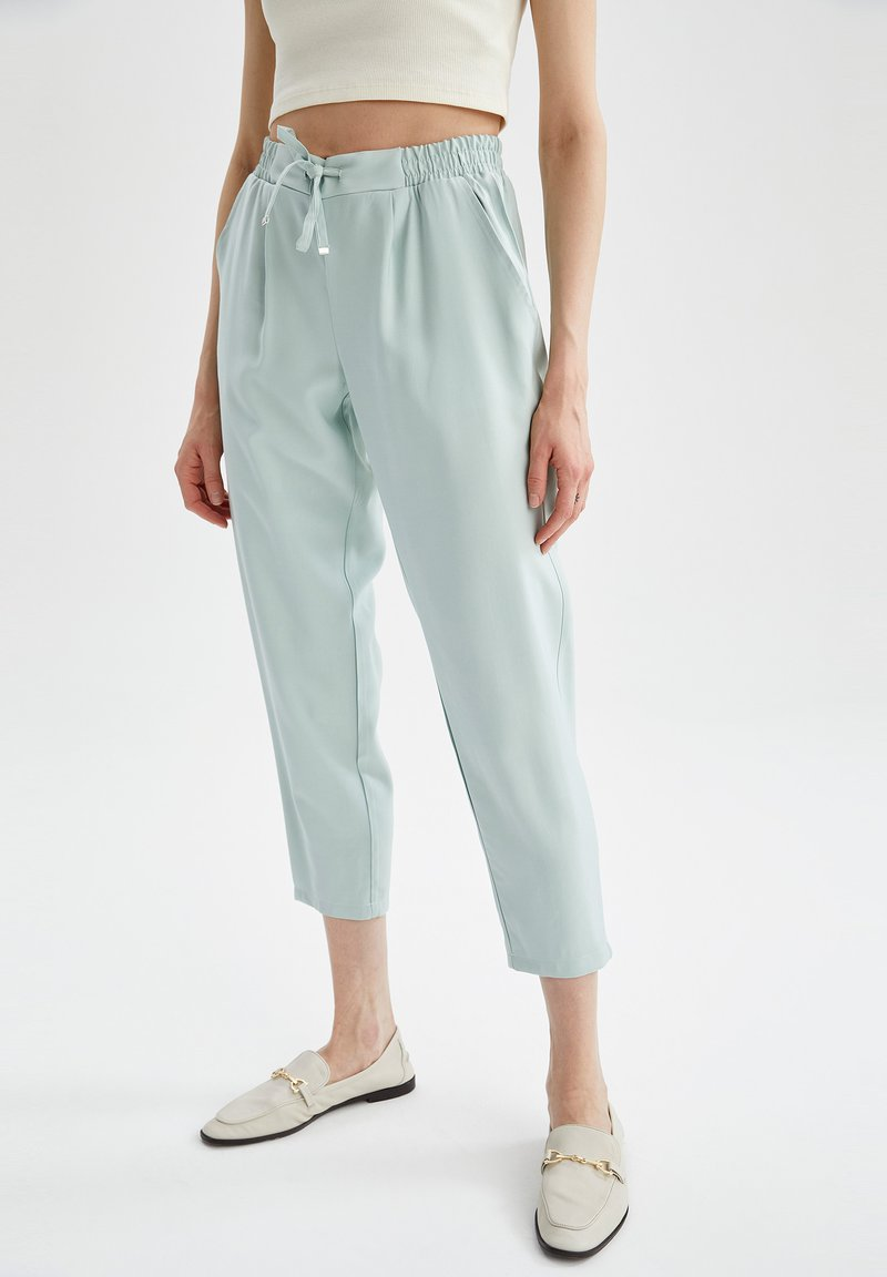 DeFacto - Tracksuit bottoms - turquoise