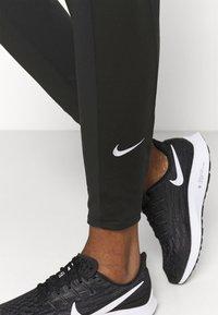 Nike Performance - WARM PANT RUNWAY - Tracksuit bottoms - black/reflective silver - 3