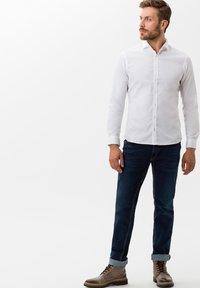 BRAX - STYLE CHUCK - Slim fit jeans - stone blue - 1