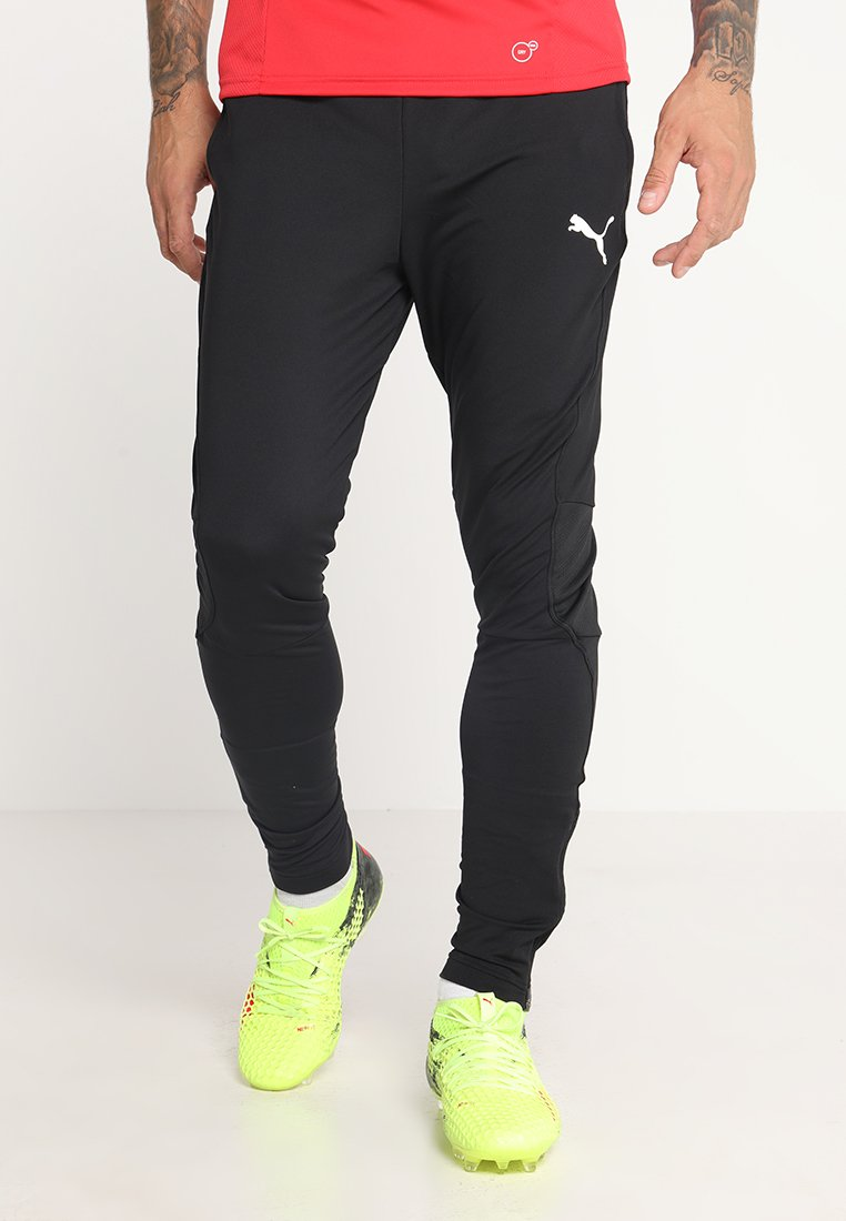 Puma - LIGA TRAINING PANTS PRO - Sportswear - black/white