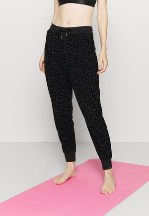 LEOPARD - Tracksuit bottoms - black