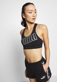 Puma - AMPLIFIED - Sports shorts - black - 3