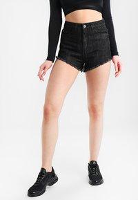 Urban Classics - LADIES HOTPANTS - Denim shorts - black washed - 0