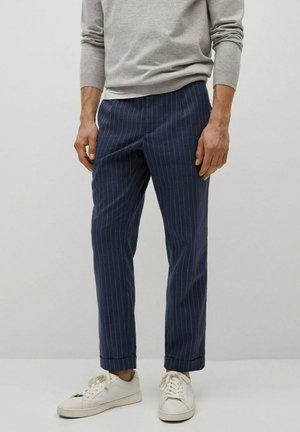 Spodnie materiałowe - dunkles marineblau