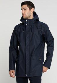 Helly Hansen - MOSS RAIN COAT - Waterproof jacket - navy - 0