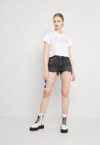 American Eagle - HIGHEST RISE - Denim shorts - washed black - 1