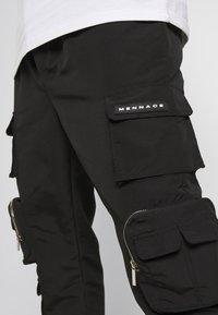 Mennace - MENNACE UTILITY TROUSER - Cargo trousers - black - 6