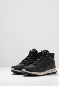 Skechers - DELSON - High-top trainers - black - 2