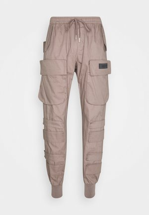 PANTS WITH MULTIPLE POCKETS - Cargo trousers - light brown