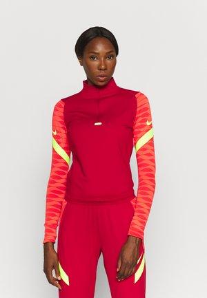 STRIKE21 - Sports shirt - gym red/bright crimson/volt/volt
