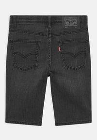 Levi's® - PERFORMANCE  - Denim shorts - black denim - 1