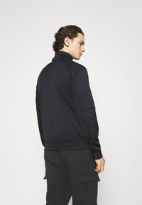 Nike Sportswear - TRIBUTE - Träningsjacka - black/white - 2