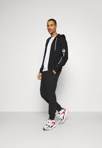 Champion - LEGACY - Zip-up hoodie - black - 1