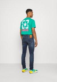 Replay - ANBASS HYPERFLEX REUSED X LITE - Jeans Tapered Fit - dark blue denim - 2