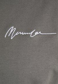Mennace - ESSENTIAL REGULAR UNISEX - T-shirt basique - washed black - 2