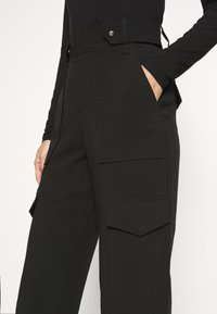 Guess - PAYTON PANTS - Trousers - jet black - 5