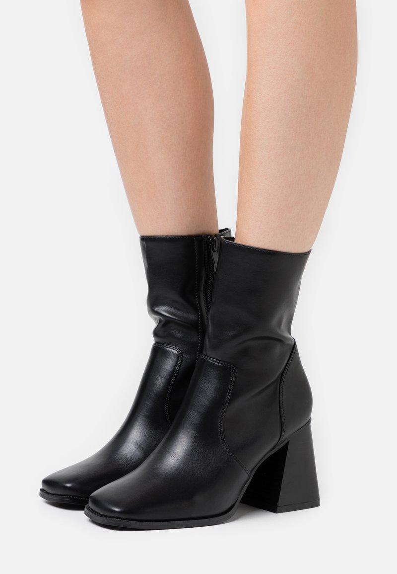 Koi Footwear - VEGAN - High heeled ankle boots - black