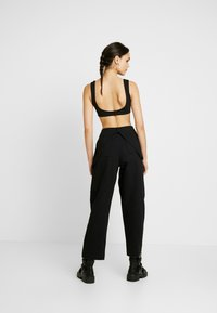 The Ragged Priest - MISTAKE PANT - Flared jeans - black - 3