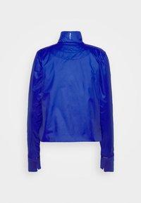 Nike Sportswear - INFLATABLE - Summer jacket - hyper blue - 9