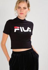 Fila - EVERY TURTLE TEE - T-shirt z nadrukiem - black - 0