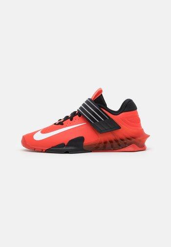 SAVALEOS UNISEX - Sports shoes - chile red/white/black/magic ember