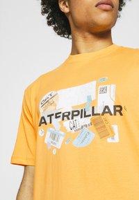 Caterpillar - POWER TEE - T-shirt med print - yellow - 5