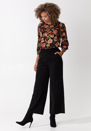 NELLA - Trousers - black