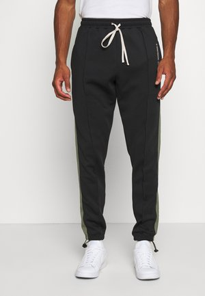 TRACKPANTS LOUNGIN BLACK - Trainingsbroek - black/green