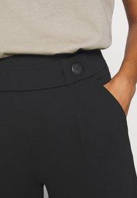 JDY - JDYGEGGO NEW ANCLE PANTS - Kalhoty - black - 4