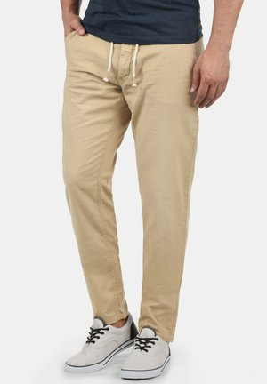 LANIAS - Trousers - chalk stone
