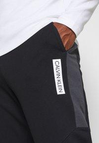 Calvin Klein Performance - PANTS - Teplákové kalhoty - black - 4