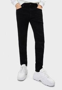Bershka - Slim fit jeans - black - 0