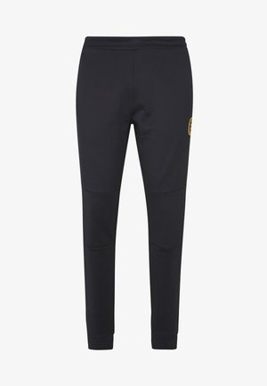CANADA AMINO - Tracksuit bottoms - black