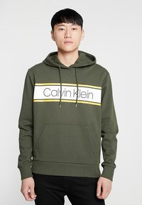 Calvin Klein - TEXT STRIPE LOGO HOODIE - Hoodie - green - 0