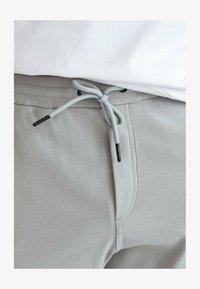 Massimo Dutti - Tracksuit bottoms - light grey - 4