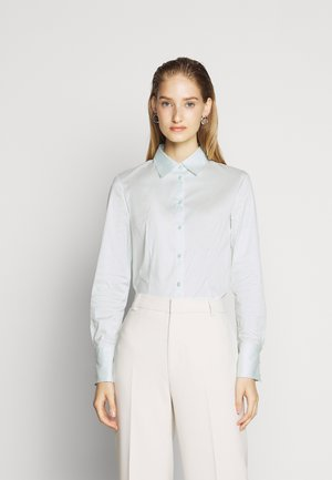 THE FITTED - Button-down blouse - light pastel green