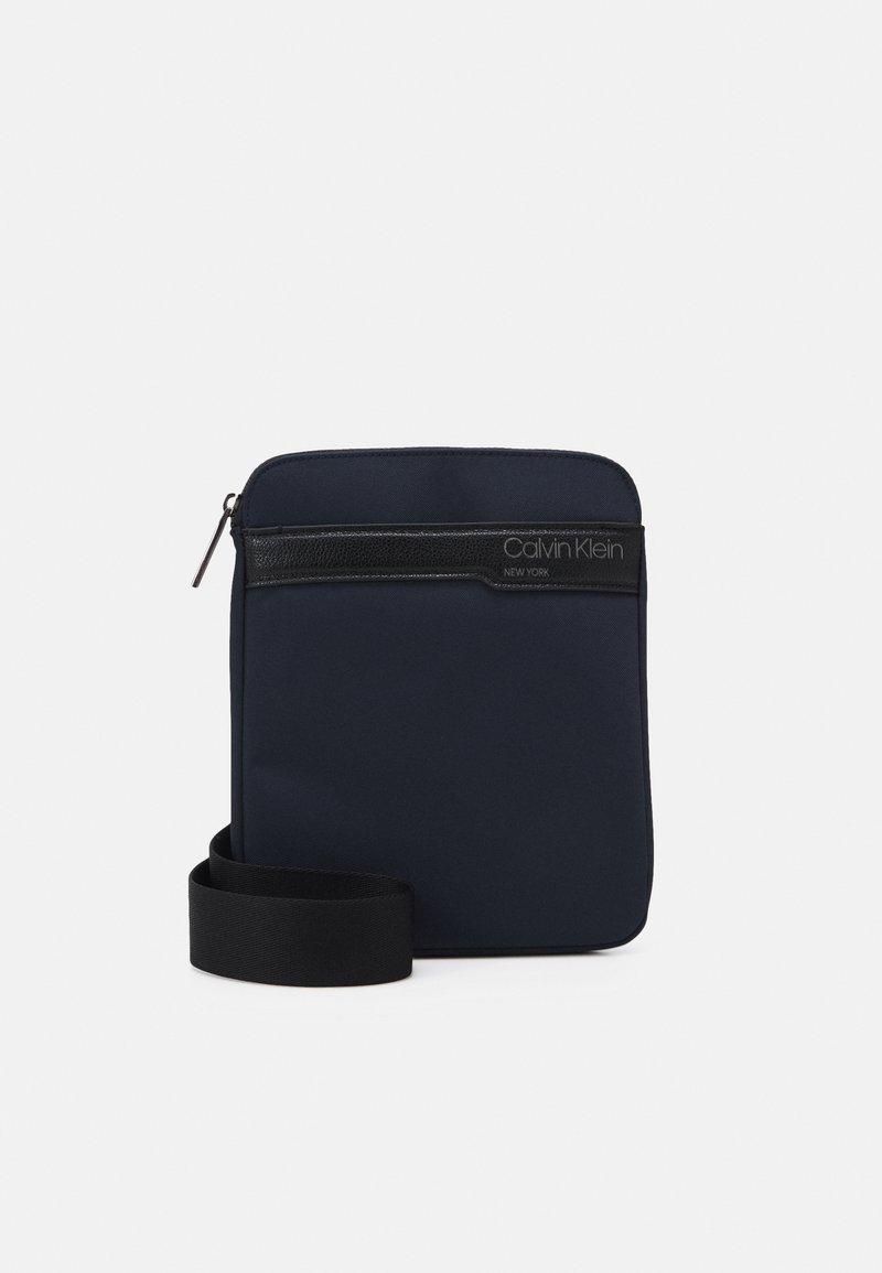 Calvin Klein - FLAT PACK UNISEX - Across body bag - blue