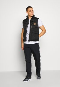 Nike Sportswear - Träningsbyxor - black - 1