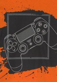 Lindex - PLAYSTATION - Long sleeved top - orange - 2