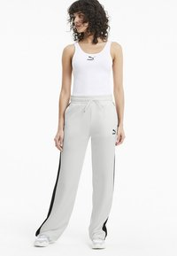 Puma - Tracksuit bottoms - white - 1