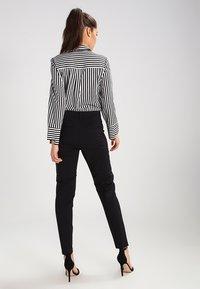 Vero Moda - VMVICTORIA - Spodnie materiałowe - black - 3