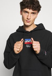 Levi's® - RELAXED GRAPHIC - Hoodie - black - 3