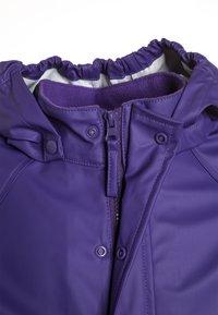 CeLaVi - RAINWEAR SUIT BASIC SET WITH FLEECE LINING - Rain trousers - purple - 5