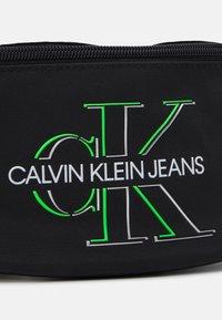 Calvin Klein Jeans - WAISTBAG GLOW UNISEX - Bæltetasker - black - 3