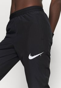 Nike Performance - RUN PANT - Verryttelyhousut - black/grey fog/white - 3