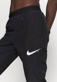 Nike Performance - RUN PANT - Pantalones deportivos - black/grey fog/white - 3